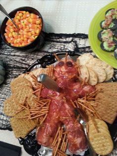 Our version of a Halloween meat and cheese plate - cheese ball covered in meats. Voodoo doll meat and cheese plate. Halloween party foods.