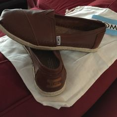 Toms leather like Beautiful Cognac color leather like Toms. Was told by a friend that they would stretch so I ordered a half a size smaller and they hurt my feet sent them back in or my regular size. With bunions and hammertoes on my feet I could not wear them. Brand-new never have been worn   Very classy looking I really wanted them bad. But threw away info to send it back NWOT TOMS Shoes Flats & Loafers