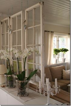 Repurposed windows suspended from ceiling become a one of a kind room divider