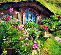 A hobbit house (New Zealand has a number of these although I don't know where this was taken) with a lush entry garden.