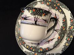 A rare Shelley Art Deco tea trio in the beautiful Swallows and balloon trees design Pattern number 11349 Vincent cup shape Black print of trees with