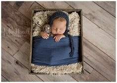 Newborn boy photographs. Love the blue wrap