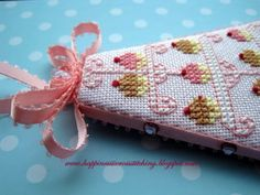Cupcake Design via Happiness is Cross Stitching.   A simple design so would be able to come up with my own :)