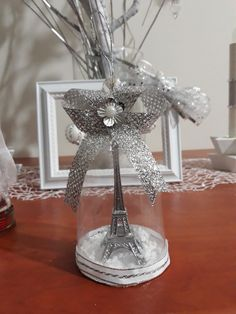 DIY Christmas tree ornament from plastic wine glass, decorated with miniature Eiffel tower and silver ribbon.