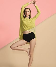 This fluid color block top is the ideal weight for every season, seeing you through the year in style. Just as ideal for spring as it is for fall, this one layer piece with hi low hem, skims over the body with grace and elegance.
