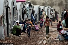 Vulnerable: Kurdish refugees from Syria today in a 'tent city' on the outskirts of the Turkish town of Suruc