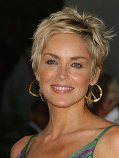 Its a toss up between Sharon Stone and Halle Berry who wears short hair the best