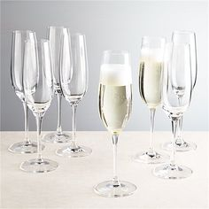 Shop Viv Champagne Glasses, Set of Everyday stemware, beautifully crafted from top to bottom. The traditional flute bowl is finished with a smooth fire-polished rim and pulled stem. Exquisite clarity at an exceptional price. White Wine Glasses, Champagne Glasses, Best Champagne, Glass Serving Bowls, Toasting Flutes, Gift For Lover, Lovers Gift, Crate And Barrel, Crates