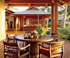 The colonial style chairs are Indonesian. A Tropical Outlook : Architectural Digest