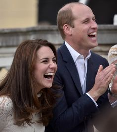 Catherine, Duchess of Cambridge and Prince William, Duke of Cambridge laugh as they host a tea party in the grounds of Buckingham Palace to honour the children of those who have died serving in the armed forces on May 13, 2017 in London.