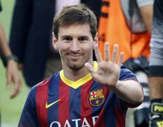 Barcelona's Lionel Messi waves to his fans before their Joan Gamper trophy soccer match against Santos in Barcelona