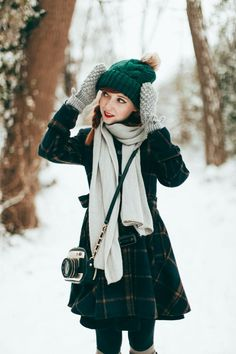 I adore the vintage feel of this winter inspired outfit!  The handknit green hat and grey mittens are so cute together. This is like the sweetest Slytherin look I've ever seen!