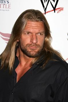 Triple H Photos - Celebrities are pictured making their way down the red carpet during the WWE's SummerSlam Kickoff Party in Hollywood. - Celebrities Arriving At The WWE's SummerSlam Kickoff Party In Hollywood Paul Michael, Stephanie Mcmahon, Prince Purple Rain, Wrestling Wwe, Triple H, Judas Priest, Roger Nelson, Prince Rogers Nelson, Ozzy Osbourne