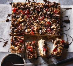 Nutty Florentine Bars This clever tray bake combines a buttery shortbread base with a Florentine inspired topping - finished with cherries and dark chocolate Bbc Good Food Recipes, Cooking Recipes, Blanched Almonds, Dried Cherries, Baked Apples, Dessert Bars, High Tea, Tray Bakes, Thermomix