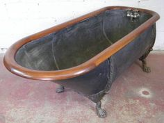 metal tub with wood rim...three thousand two hundred fifty dollars at columbus architectural salvage.