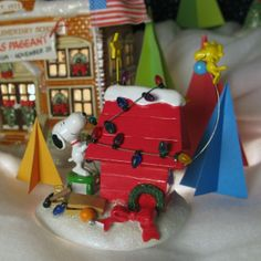 Snoopy & Woodstock are decorating the doghouse up right! House and Figurine from Department 56.