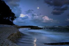 The moon before sunrise on the beach in Jarosławiec, the Baltic Sea