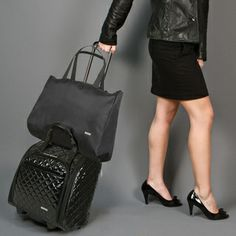 Travel in class with this black wheeled under-seat carry-on bag. Designed to store safely beneath your plane seat as you travel, this sleek black bag features built-in pockets for convenient organizat