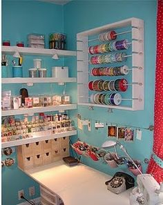 An organised craft room. Look at way ribbon holder is made for drying rack