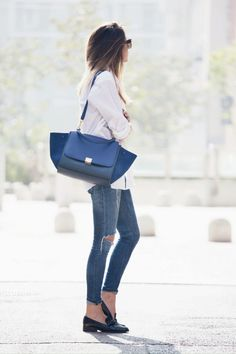 justthedesign:Nicoletta Reggio is wearing a white shirt and jeans both from Zara, blue trapez bag fromCeline and shoes from Sarenza
