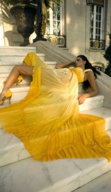Draped in Yellow & Flowing Down the Steps