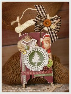 Decorated Christmas Sled Ornament.  Make your own DIY Sled Ornament with these instructions --> http://pinterest.com/pin/183521753537206782/