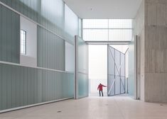 Slideshow:Madrid studioExit Architects designed this concrete sculpture museum behind the retained facade of an old house in southern Spain. Translucent glazed walls connect the existing brick walls to the new three-storey-high structure, which is recessed by a few metres to create a public plaza at the mainentrance. Concrete tiles clad the exterior of themuseum, while