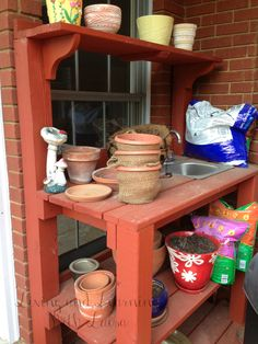 I love this potting station / stand. broad work surface with a shelf at tope, and a shelf underneath for storage.