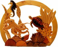 Hawaiian Wood Wall Hanging Octopus's Garden by Buns of Maui. $44.49. Hawaiian Home Accessories will add a warm tropical touch to your home or office!. Each piece of wood in this realistic underwater tableau is carved and carefully assembled by hand. The remarkable and varied colors of the marquetry woods are all natural, no staining, painting or dyeing is used, making each marquetry piece a truly one of a kind multi dimensional work of art. Exotic hardwoods such as ebony, rosew...