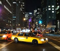 Taxi cab at night, Park Avenue, midtown. New York City. October 2, 2013.  To see much more of NYC, come on a walking tour:  http://www.wallstreetwalks.com