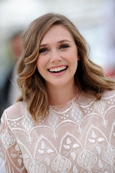 First, I think she is adorable. Two, she is an Olsen, can you tell? Three, I like her length of hair:)