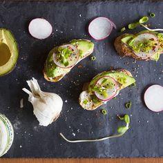 An easy #vegan breakfast: Pesto #Vegenaise, avocado, radish, sprouts, and herbs on toast. #yum #avocadotoast