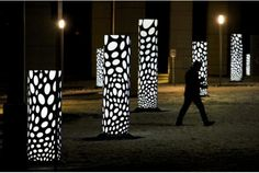 Mitosis Courtyard -- Two-dozen columns with circular patterns inspired by cell division.