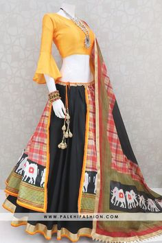 Tempting Black/Light Orange Flap Patola Print Chaniya Choli Set Palkhi fashion presets black flap chaniya choli with patola silk flap layer highlighted with light orange bell sleeve blouse & silk printed dupatta. Indian Fashion Dresses, Indian Gowns Dresses, Dress Indian Style, Girls Fashion Clothes, Indian Designer Outfits, Indian Outfits, Saree Blouse Neck Designs, Choli Designs, Lehenga Designs