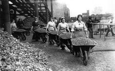 Lady navvies pushing loaded wheel barrows in Coventry, 1917