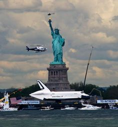 A NYPD chopper is among the convoy of ships and helicopters which escorts the space shuttle Enterprise past the Statue of Liberty on June 6, 2012. TODD MAISEL/NEW YORK DAILY NEWS