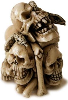 An early twentieth-century Japanese carved ivory netsuke in the form of six skulls with slithering snakes. (buddhamuseum.com)