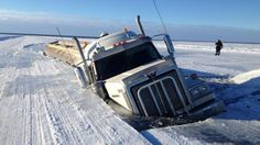 A fuel truck went through the ice on the Deline access road Saturday.