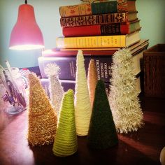 Mini Christmas Trees made from recycled cardboard and wrapped with yarn.