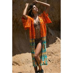 Bowerbird Saraswati by Arnhem - Amazing bowerbird kimono with big wide kimono sleeves in soft fabric, feels like silk. Hand printed print with Arnhem's new design Saraswati, a mix of bright orange and turquoise. A kimono that only gets better with age. Rayon material.