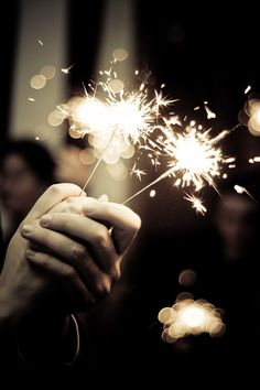 Exquisite - burning sparklers outside at night to create instant celebration of anything.