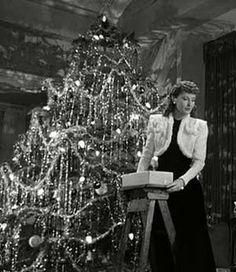 "§§§ : Barbara Stanwyck tinsels the tree in the movie ""Christmas in Connecticut"""