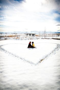 Cute winter engagement photo! It would be fun to take pictures of a snow fight or go sledding too..hmm..