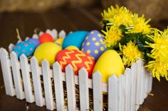 colorful easter decorative eggs in wooden box