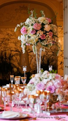 Tall centerpiece with blooming spirea tendrils. Echoes the cherry blossoms.