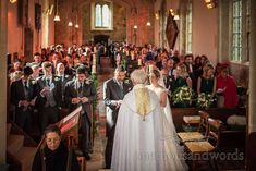 Looking down the aisle at Lulworth Estate church wedding in Dorset #churchwedding #dorsetwedding #weddingceremony