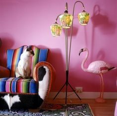 Pink living room with a chair upholstered in a colorful Mexican-style fabric - Photography by Wilfried Overwater