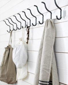 HJÄLMAREN towel rack used in bedroom for wall storage