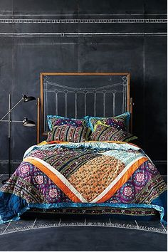 Dramatic, bold bedroom. Love the colors and pattern