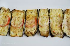 Eggplant sliced lengthwise, brushed with olive oil, sea salt. Bake 10 min on 350. Top with tomato and cheeses Bake on 350 10-15 min.